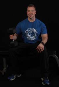 Sculpt Fitness Trainer Chad Maleski holding dumbbell